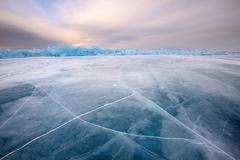 Cracked patterned ice, Baikal Lake, Olkhon Island, Siberia, Russia Stock Photos
