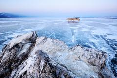 Distant view of Borga-Dagan Island, Baikal Lake, Olkhon Island, Siberia, Russia - stock photo