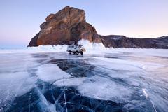 Off road tourist vehicle at Khoboy Cape, Baikal Lake, Olkhon Island, Siberia, - stock photo