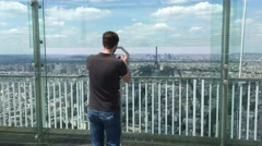 Man Watches Paris From Montparnasse Tower Panoramic Observation Deck, 4K Stock Footage