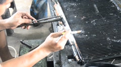 Thai people use lead and gas welding for fix and solder radiator of car - stock footage