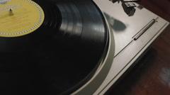 The man turns the music on vinyl Stock Footage