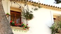 Beautiful window with red flowers. Spain, Altea Stock Footage