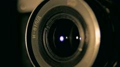 Old retro style camera lens in the dark studio rounding light indoors Stock Footage
