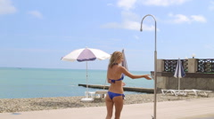 Young Woman Under Shower at the Summer Beach Stock Footage