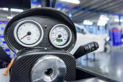 Speedometer detail in racing car factory Stock Photos