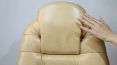 Female Hand Touching New Leather Office Boss Chair (armchair) - stock footage