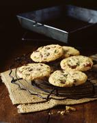 Pistachio and cranberry oat cookies, vintage props, wooden table - stock photo