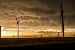 Mammatus clouds and light over wind farm in rural Kansas Stock Photos