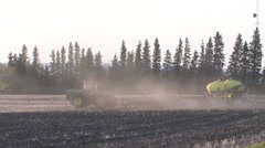 Farm tractor seeding crop at sunset Stock Footage