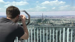 Man Watches Paris From Telescopic Sight On Top Of Montparnasse Tower, 4K Stock Footage