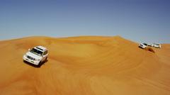 Aerial Dubai Drone view of Desert Safari vehicles dune bashing Stock Footage