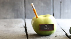 Back to school background - inscription and pencil and apple on the table Arkistovideo