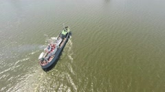 Drone flies over military ship on the river with drawbridge Stock Footage