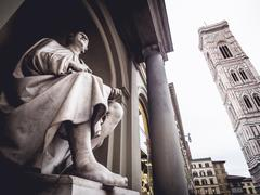 Italy Florence Statue of Filippo Brunelleschi and Giotto's bell tower - stock photo
