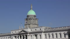 Custom House Dublin deep blue sky flags flying green dome Stock Footage