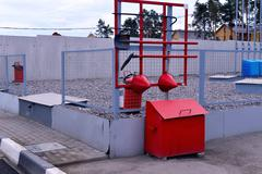 Fire Shield on the wall. Set primary fire extinguishing equipment. - stock photo