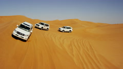 Aerial Dubai Drone view of Desert Safari vehicles dune bashing Stock Footage