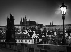 Charles Bridge at sunrise, Prague, Czech Republic. Dramatic statue and view o Stock Photos