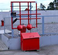 Fire Shield on the wall. Set primary fire extinguishing equipment. Stock Photos