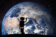 Robot looking on the planet Earth from space. Future technology concept, arti Stock Photos