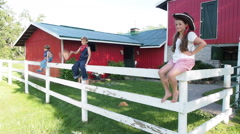 Country Kids Sitting On Farm Fence Stock Footage