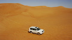 Aerial Drone of 4x4 Vehicles Driving Across Dubai Desert Sands Stock Footage