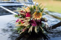 Beautiful wedding bouquet on car hood Stock Photos
