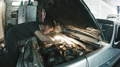 Car mechanic details of the car in the car service, wide angle, slider - stock footage