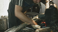 Car mechanic details of the car in the car service - stock footage