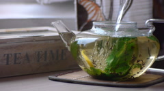 Pouring Boiling Water Into The Transparent Glass Teapot Stock Footage
