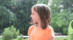 Girl playing in rain - stock footage