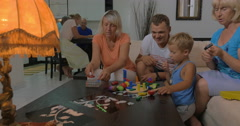 Boy and his family playing with toys at home - stock footage