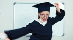 Graduate dancing. Student 7-8 years in the mantle Stock Footage