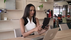 Businesswoman has conference call with partner on the touch screen tablet - stock footage