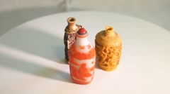 Three carved Chinese snuff bottles Stock Footage
