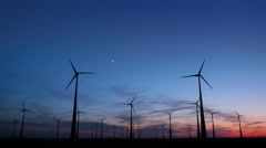 Wind Turbines and the Moon in the Blue-Red Sky Stock Footage