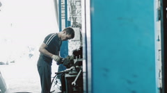 Mechanical repairs a part of the car in car service use Water Displacement Stock Footage