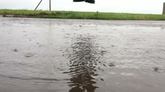 Jumping in a puddle slow motion Stock Footage