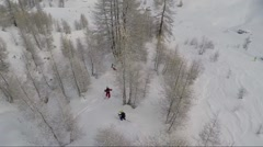Aerial of skiers skiing on mountain Stock Footage