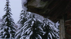 Snow covered house on mountain during snowfall Stock Footage