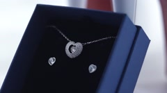 Pendant and Earrings in a blue box - stock footage