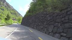 Switzerland Grindelwald road in valley village Stock Footage