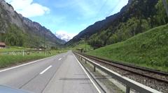 Road in Alpine valley Switzerland Stock Footage