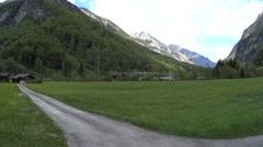 Grindelwald valley old village houses road trip Stock Footage