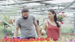 4K Cheerful couple shopping in garden center Stock Footage