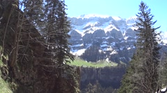 Hiking in Alps mountains Switzerland green summer Stock Footage