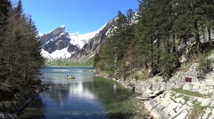 Switzerland kayaking lake Alps mountains - stock footage