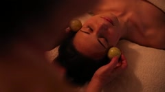 Stone therapy head massage for a girl Stock Footage