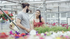4K Cheerful couple shopping in garden center Stock Footage